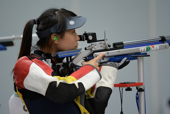 China's Zhang Binbin competes in the women's 10m air rifle individual final of the 2014 Asian Games in Incheon on September 22, 2014.    AFP PHOTO / Prakash SINGH        (Photo credit should read PRAKASH SINGH/AFP/Getty Images)